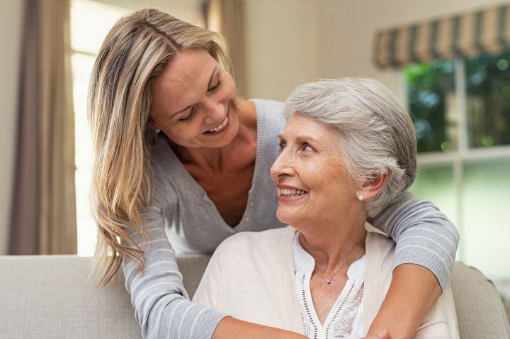 woman-embracing-senior-mother-TQJF2Z6.jpg