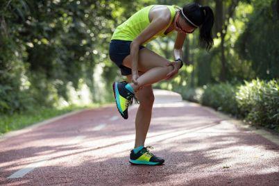 woman-runner-warming-up-on-park-XNSKYPM.jpg
