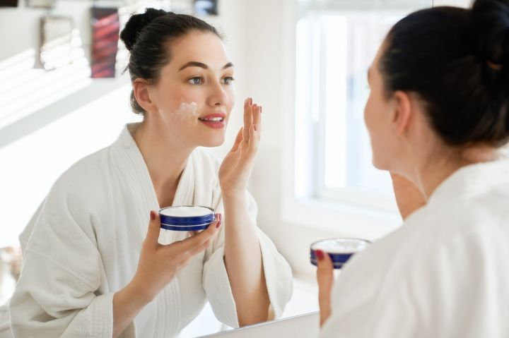 woman-with-cream-for-her-face-MJ3AH6X.jpg