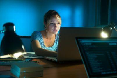 woman-writing-on-laptop-computer-late-at-night-PUGN7MU.jpg