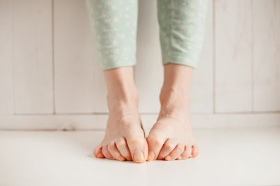 womens-tired-ankles-with-clasped-fingers-and-P9WFW59.jpg