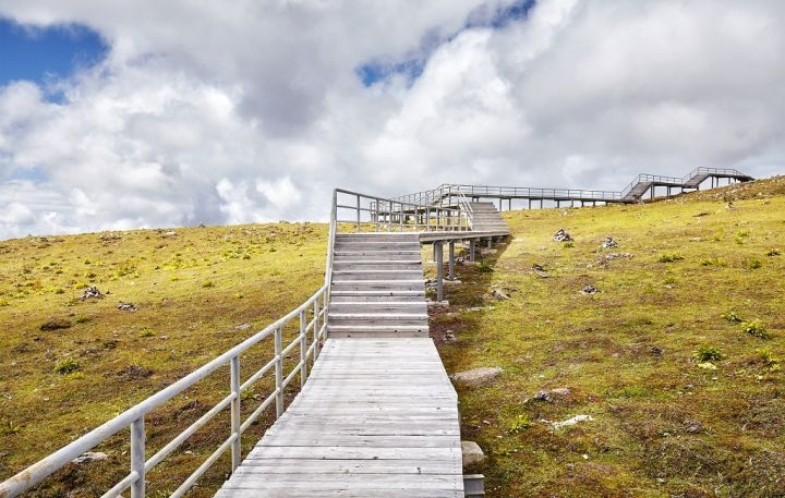 wooden-walkway-in-the-shika-snow-mountain-area-PMYJPE5.jpg
