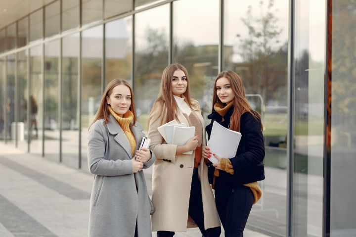 young-students-on-a-student-campus-standing-with-a-ETWVEPT.jpg