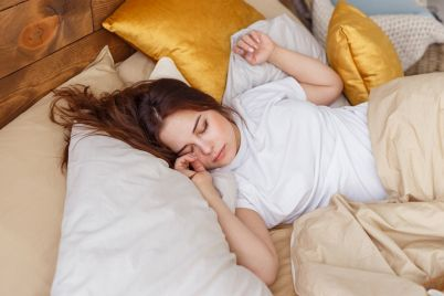young-woman-sleeping-in-bed-PZBJ96W.jpg