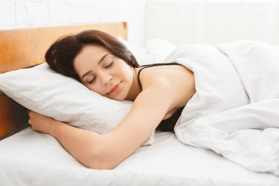 young-woman-sleeping-in-bed-close-up.jpg
